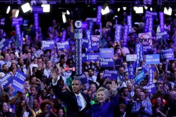 U.S. President Barack Obama and Democratic presidential candidate Hillary Clinton wave to the crowd after the President spoke at the Democratic National Convention in Philadelphia