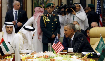 U.S. President Barack Obama speaks with Abu Dhabi's Crown Prince Sheikh Mohammed bin Zayed al-Nahyan during the summit of the Gulf Cooperation Council (GCC) in Riyadh