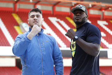 Dave Allen poses with Lenroy Thomas after the press conference