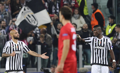 Juventus Zaza celebrates with his team mate Pogba after scoring against Sevilla's during their Champions League group D soccer match at Juventus stadium in Turin