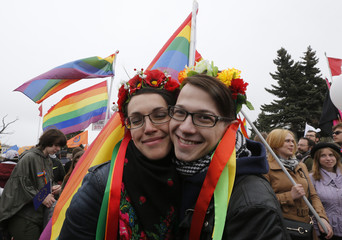 Gay rights activists take part in a May Day rally in St. Petersburg