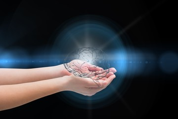 Digital composite of Brain on hands