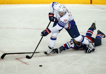 Slovakia's Sekera fights for the puck with France's Treille during their 2013 IIHF Ice Hockey World Championship preliminary round match at the Hartwall Arena in Helsinki