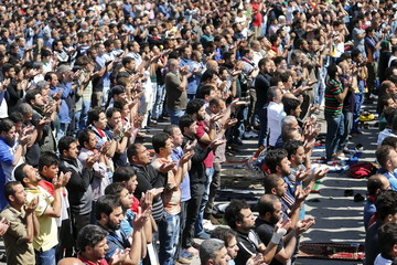 Supporters of prominent Iraqi Shi'ite cleric Moqtada al-Sadr pray during a sit-in in Baghdad