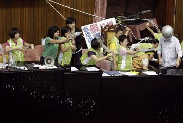Legislators from the opposition DPP splash water at legislators from the ruling KMT at the Legislative Yuan in Taipei