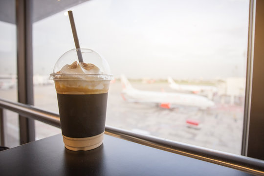 Cup of ice coffee. travelling relax time waiting for the journey coming.