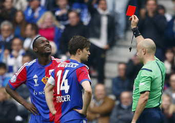 Referee Graf shows a red card to FC Basel's Sio during their Swiss Cup final soccer match against FC Zurich in Bern