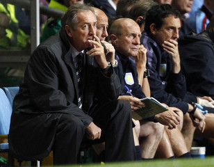 Aston Villa's manager Houillier watches during their English League Cup soccer match against Blackburn Rovers in Birmingham