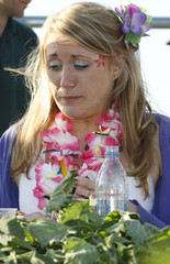 Gray grimaces as she competes in the annual Nettle Eating World Championships during a hen party at Bottle Inn pub in Marshwood