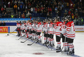 Canada's players stand on the ice after they were defeated by the U.S. in their semi-final game at the 2013 IIHF U20 World Junior Hockey Championship in Ufa