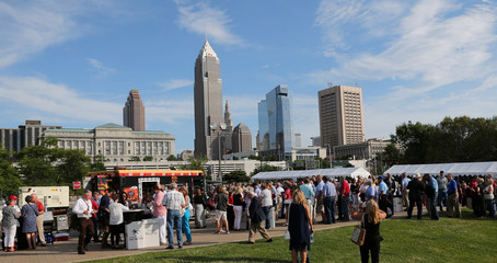 Guests mingle around with the Cleveland skyline in the background at a Rock the Night kick off party on the sidelines of the Republican National Convention in Cleveland