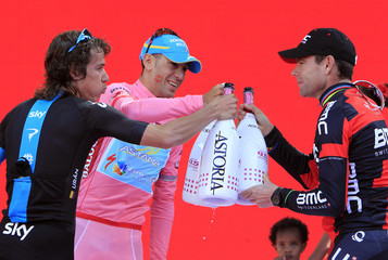 Pink jersey holder and overall leader Nibali celebrates on the podium with Sky's Uran of Colombia and BMC's Evans after the Giro d'Italia cycling race from Riese Pio X to Brescia