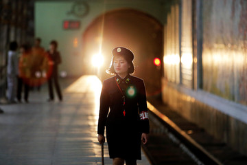 A subway worker walks away after a train departed the station in central Pyongyang