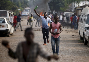 A protester gestures during a protest against Burundi President Pierre Nkurunziza and his bid for a third term in Bujumbura