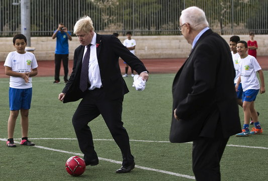 """London Mayor Johnson and Israel's President Rivlin play soccer during the launch of the new soccer season in Jerusalem of the """"Equalizer"""" organization which works with Jewish and Arab children across the country"""