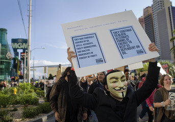 "Brancaccio wearing a Guy Fawkes mask marches during an ""Occupy Las Vegas"" demonstration on the Las Vegas Strip in Las Vegas"