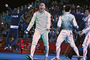 Japan's Yuki Ota and team mates celebrate their victory against Germany at the end of the men's foil team semifinals fencing competition during the London 2012 Olympic Games
