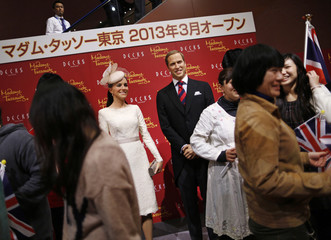 Guests wait for a photo session with wax figures of Britain's Prince William and his wife Catherine, Duchess of Cambridge, during a media briefing at the Madame Tussauds Tokyo museum