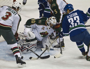 Wild's Theordore blocks a shot from Canucks' Sedin during their NHL hockey game in Vancouver