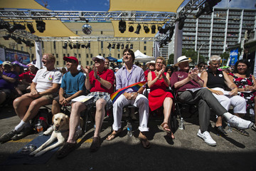 Justin Trudeau, Kathleen Wynne, Bob Rae, Jane Rounthwaite attend an outdoor church service before the gay pride parade in Toronto