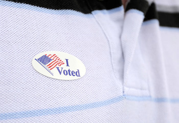 A voter wears a sticker after voting in the U.S. presidential election at the Robert Guevara Community Center in Kissimmee, Florida