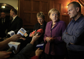 German Chancellor Merkel and Polish PM Tusk brief media on details of a fatal accident in Berlin