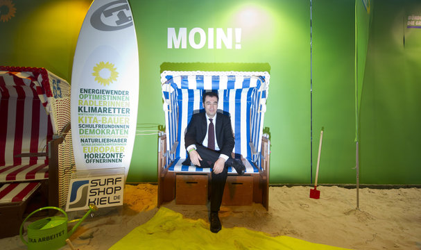 Germany's Green Party co-leader Oezdemir poses in roofed wicker beach chair in Kiel