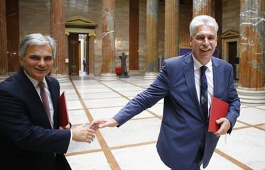 Austrian Chancellor Faymann listens to Finance Minister Schelling in the Parliament in Vienna