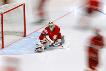 Goaltender Kevin Lalande of Belarus stretches before their Ice Hockey World Championship game against Russia at the CEZ arena in Ostrava