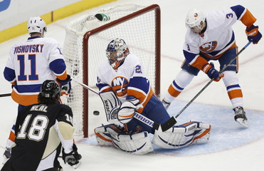 Islanders goaltender Nabokov watches as Penguins' Murray scores a goal during Game 5 of their NHL Eastern Conference quarter-final hockey game in Pittsburgh