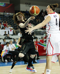 Japan's Yoshida passes the ball against Canada's Phillips during their 2012 women's FIBA Olympic Qualifying Tournament in Ankara