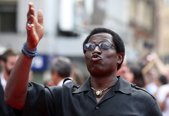 """Cast member Wesley Snipes poses for a photograph as he arrives for the world premiere of the film """"The Expendables 3"""" at Leicester Square in London"""