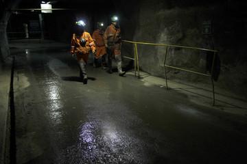 Workers from El Teniente copper mine walk along a tunnel inside the mine near to Rancagua city