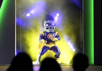 """A zombie character from the video game """"Plants vs. Zombies: Garden Warfare 2"""" appears on stage during Electronic Arts media briefing before the opening day of the E3, at the Shrine Auditorium in Los Angeles"""