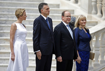 Princess Charlene of Monaco, Montenegro's President Filip Vujanovic, Prince Albert II of Monaco and Svetlana Vujanovic listen to the national anthems in the main courtyard of the Monaco Palace