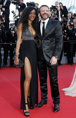 "Actor Samuel Le Bihan and his wife pose on the red carpet as they arrive for the screening of the animated film ""Inside Out"" out of competition at the 68th Cannes Film Festival in Cannes"