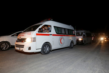 A Red Crescent convoy carrying wounded people who were evacuated from the besieged Damascus suburb of Daraya, after an agreement reached on Thursday between rebels and Syria's army, arrive in the rebel-controlled Qalaat al-Madiq town in Hama province
