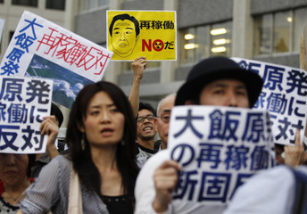 Protesters against the restart of nuclear power plants, shout slogans in front of the Japanese prime minister's official residence in Tokyo