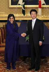 Pakistan's Foreign Minister Khar shakes hands with her Japanese counterpart Gemba at the start of their meeting at the foreign ministry's Iikura Guest House in Tokyo