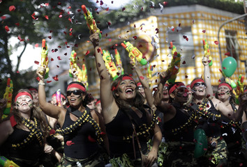 """Revellers dance during the annual block party known as the """"Suvaco do Cristo"""" (Armpit of Christ), one of the many pre-carnival parties to take place in the neighbourhoods of Rio de Janeiro"""