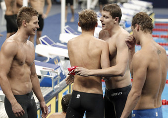 Russian team reacts after competing in men's 4 X 100m medley relay heats at 14th FINA World Championships in Shanghai