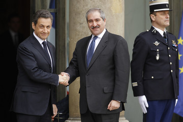 France's President Sarkozy greets Jordanian Foreign Minister Joudeh at the Elysee Palace ahead of international talks on Libya in Paris