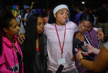 Friends who were with Trinity Gray at the time of her death speak before a candlelight vigil at Lafayette High School in Lexington