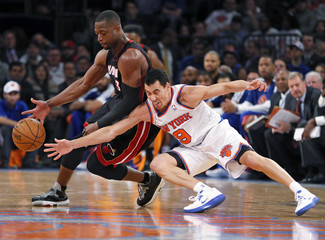Knicks' Prigioni tries to steal the ball from Heat's Wade in the fourth quarter of their NBA basketball game in New York