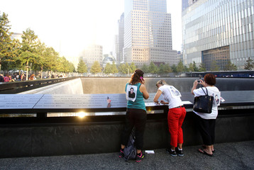 Family members of Jason Defazio who perished in Tower One visit the  9/11 Memorial during ceremonies marking the 12th anniversary of the 9/11 attacks on the World Trade Center in New York