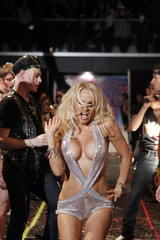 Pamela Anderson presents a creation from the A*MUSE Fall 2010 collection during New York Fashion Week