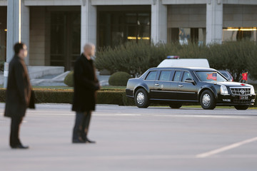 U.S. President Barack Obama arrives in a motorcade before leaving on Air Force One at the Beijing Capital International Airport after attending the APEC Summit