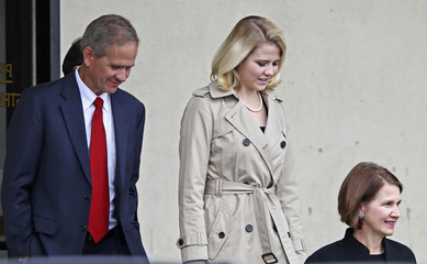 Elizabeth Smart, her father Ed and mother Lois leave Federal Court in Salt Lake City