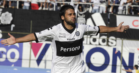 Maximiliano Biancucchi of Olimpia celebrates after scoring against Rubio Nu during their Paraguayan first division soccer match at the Defensores del Chaco Stadium in Asuncion