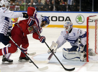 Jagr of the Czech Republic attempts to score a goal against France's goaltender Hardy during their Ice Hockey World Championship game in Prague